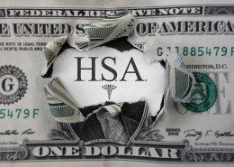 Torn dollar with HSA ( Health Savings Account ) paper message