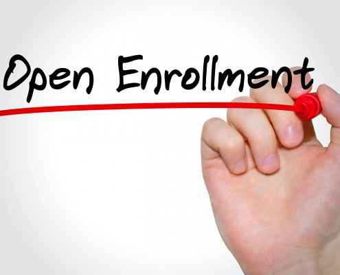 Hand writing inscription Open Enrollment with marker, concept